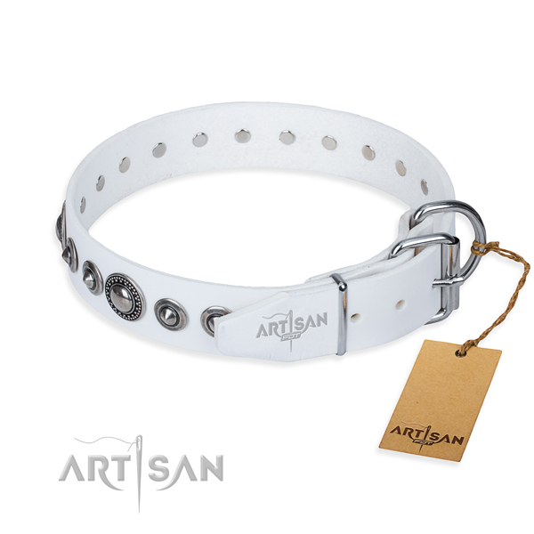 Natural genuine leather dog collar made of flexible material with corrosion resistant adornments