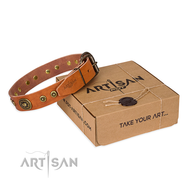 Leather dog collar made of soft to touch material with corrosion proof traditional buckle